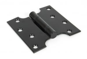 An image of a black door hinge handmade by ironmongers and sold by Heart of Wood.