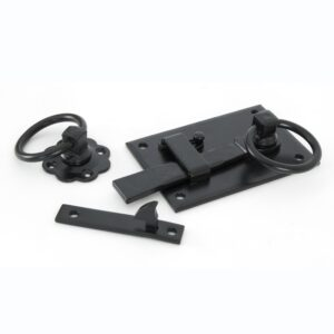 An image of a black right handed cottage latch set, sold with matching wood screws and a spindle.
