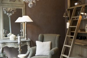 An image showing a cosy sitting room with a vintage aesthetic.