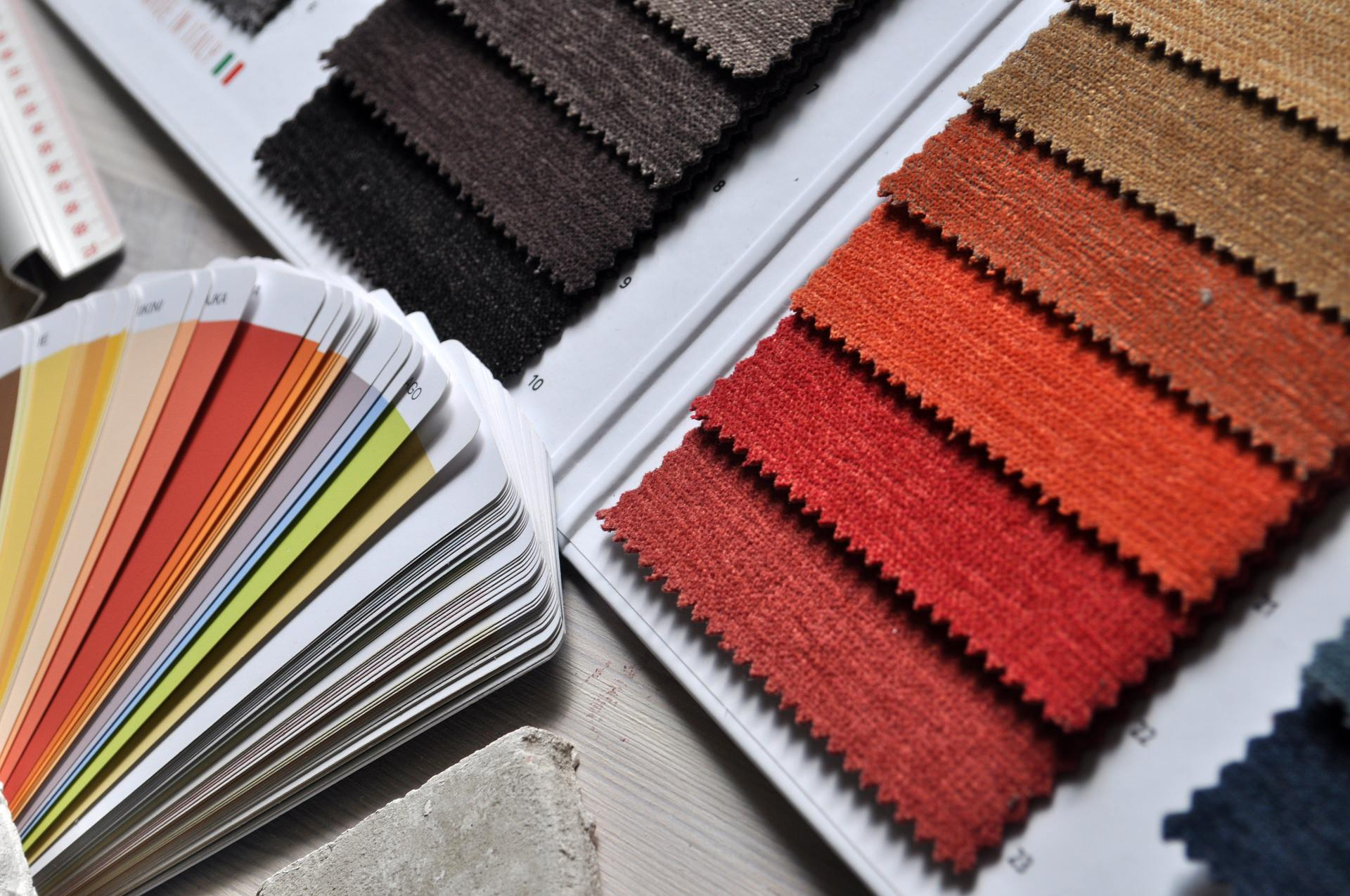 An image showing various colour charts and coloured fabrics, demonstrating the room colours available.