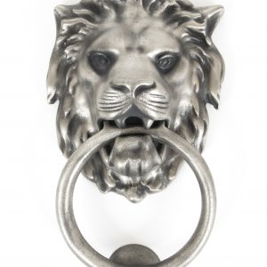 An image of lions head door knocker in a matte silver finish.