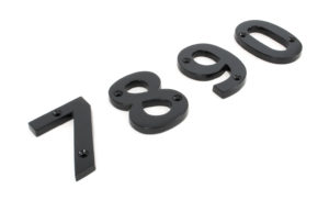 An image of a selection of front door numbers made from iron with a black finish.