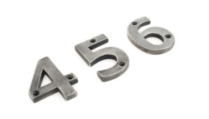 An image of the numbers, 4,5 and 6 mad to go on the outside of a property, made from iron and finished in a matte silver colour.