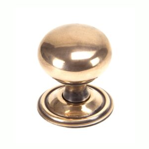 An image of a gold cabinet knob.