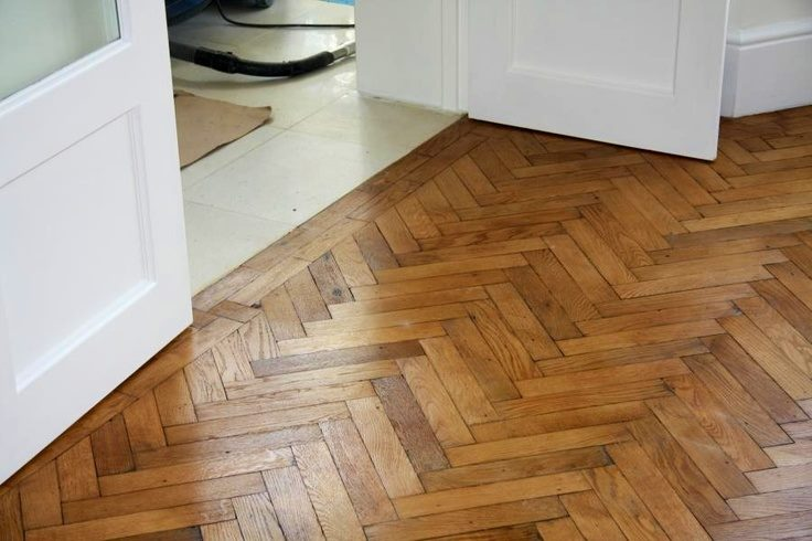 An image of herringbone parquet flooring laid in a home.
